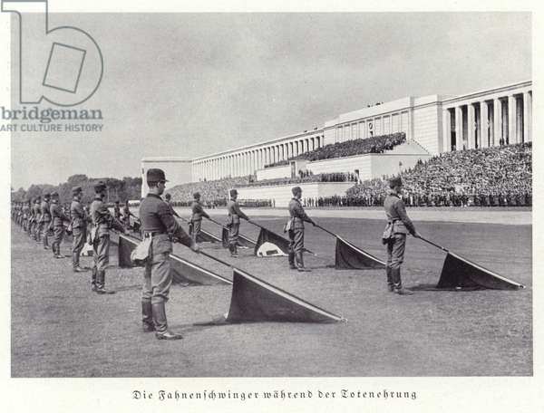 Flag wavers during the honouring of the dead, Nuremberg Rally, 1936 (b/w photo)