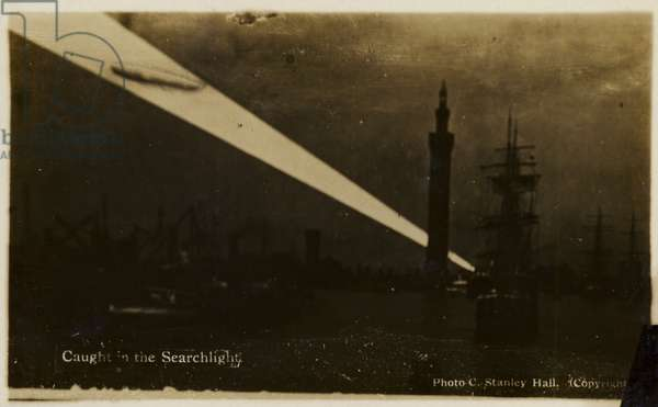 German Zeppelin caught in a searchlight, World War I (b/w photo)