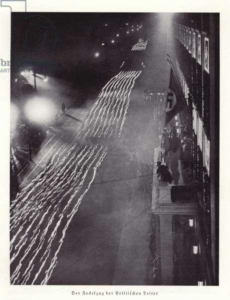 Torchlit procession of Nazi political leaders, Nuremberg, 1936 (b/w photo)