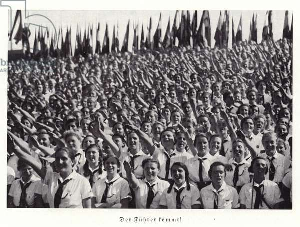 Members of the League of German Girls saluting Hitler, Nuremberg Rally, 1936 (b/w photo)