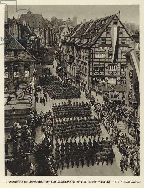 52,000 men of the Reichsarbeitsdienst (Reich Labour Service) marching at the Nuremberg Rally, 1934 (b/w photo)