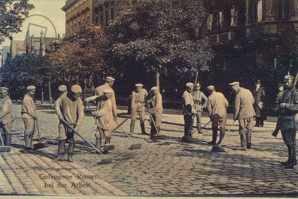 Russian prisoners of war captured by the Germans put to work sweeping the streets, World War I, 1914-1918 (colour photo)