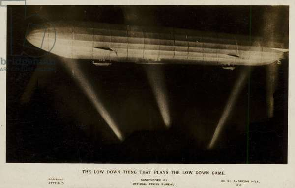 The low down thing that plays the low down game; a Zeppelin caught in searchlight beams, World War I (b/w photo)