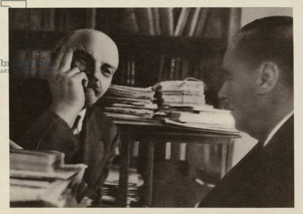 Russian Bolshevik leader Vladimir Lenin in his office in the Kremlin, having a discussion with the English writer H G Wells, Moscow, 1920 (b/w photo)