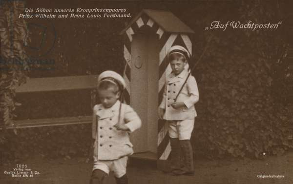 Prince Wilhelm and Prince Louis Ferdinand, sons of Crown Prince Wilhelm of Germany, pretending to be on sentry duty, armed with sticks, 1914 (b/w photo)