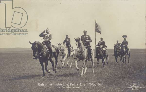 Kaiser Wilhelm II of Germany and his second son, Prince Eitel Friedrich of Prussia, on horseback at a parade, early 20th Century (b/w photo)