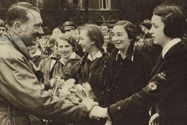 Adolf Hitler meeting girls of the Bund Deutscher Madel (BDM) (b/w photo)