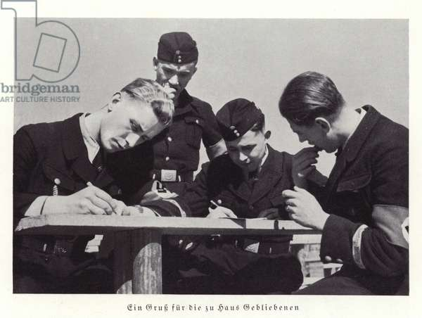 Nazis attending the Nuremberg Rally writing letters home, 1936 (b/w photo)