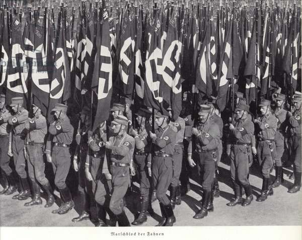 March of massed Nazi flags, Nuremberg Rally, 1936 (b/w photo)