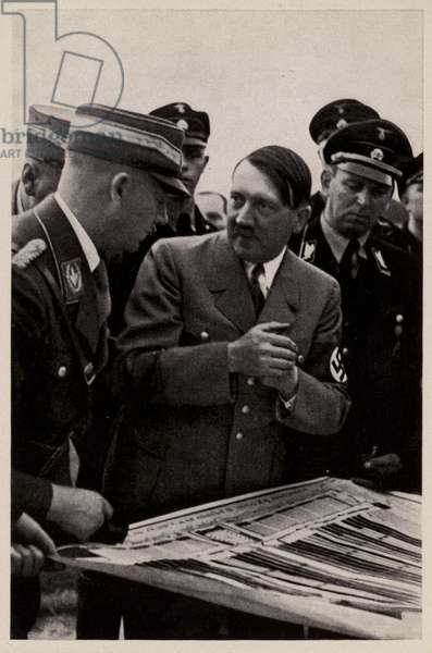 Nazi leader Adolf Hitler at the planning of the 1935 Nuremberg Rally, Germany (b/w photo)
