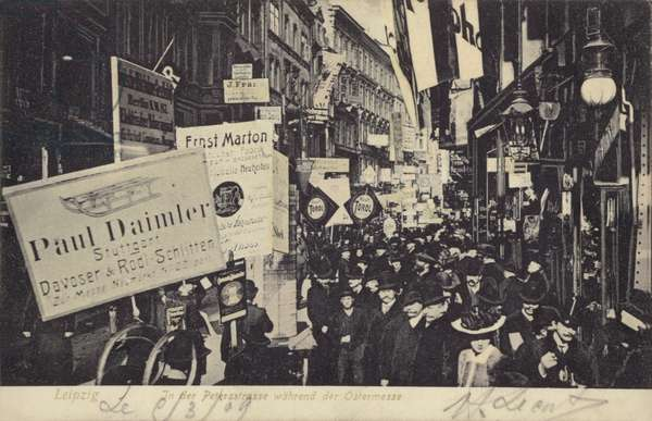 Parade of people carrying placards advertising businesses, Leipzig, Germany (b/w photo)