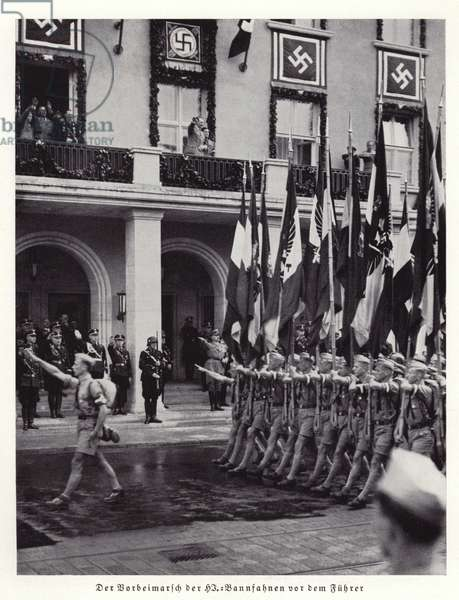 Banners being paraded past Hitler, Nuremberg, 1936 (b/w photo)