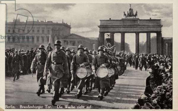 German soldiers parading on Pariser Platz in front of the Brandenburg Gate, Berlin, 1930s (b/w photo)