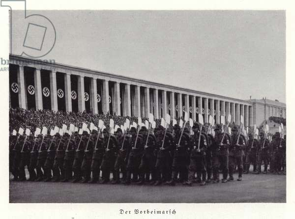 Workers of the Reichsarbeitsdienst (Reich Labour Service) marching past the grandstand, Nuremberg Rally, 1936 (b/w photo)