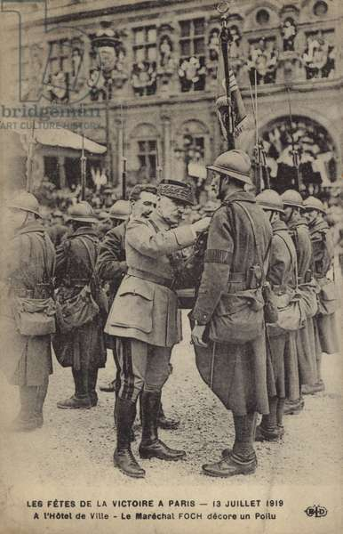 Marshal Foch pinning a medal on a French soldier at the Paris Victory Parade, 14 July 1919 (b/w photo)