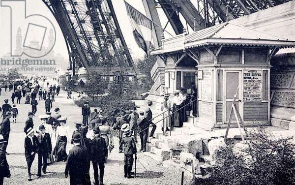 People queueing to visit the Eiffel Tower, Paris, France (b/w photo)