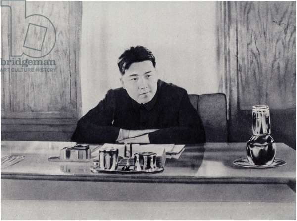 Comrade Kim Il-sung at his office at the People's Council of North Korea (litho)