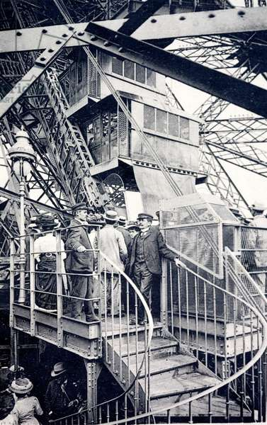 Tourists visiting the Eiffel Tower, Paris, France, c1910 (b/w photo)
