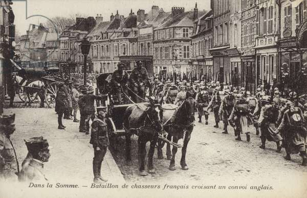 Battalion of French chasseurs passing a British convoy, Somme, France, World War I (b/w photo)