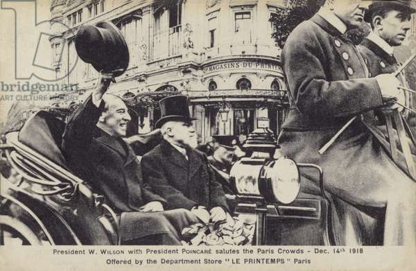 President Woodrow Wilson with President Poincare salutes the Paris crowds (b/w photo)