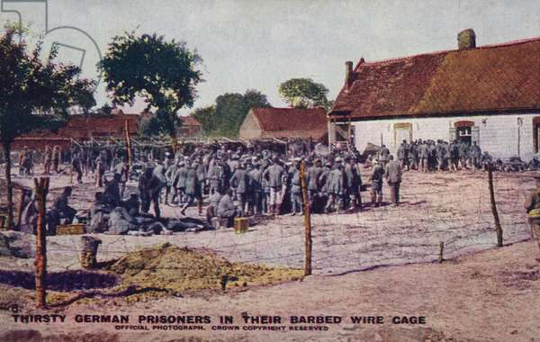 Thirsty German prisoners in their barbed wire cage, World War I (coloured photo)