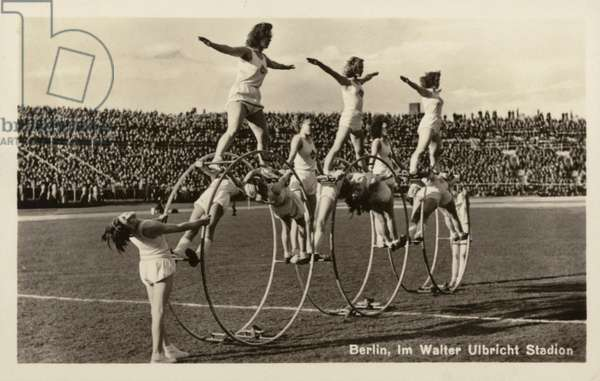 Girls performing a gymnastics display in the Walter Ulbricht Stadium, East Berlin, East Germany, 1960s (b/w photo)