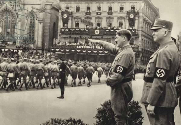 Adolf Hitler reviewing a march-past by members of the SA, Leipzig, 1933 (b/w photo)