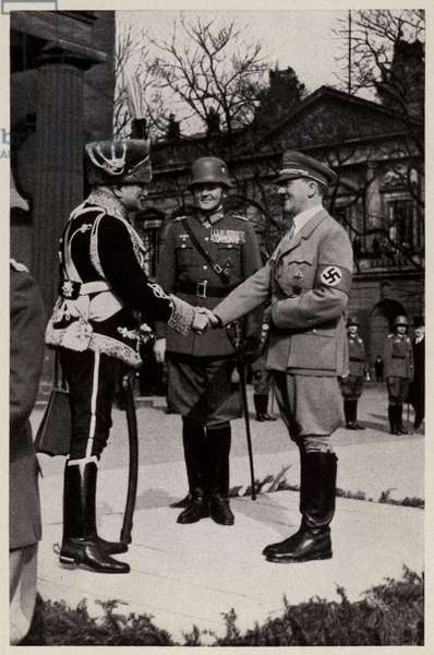 Nazi leader Adolf Hitler greeting World War I Field Marshal August von Mackensen for the 1935 Commemoration of Heroes day, in front of the New Guard House memorial in Berlin, Germany (b/w photo)
