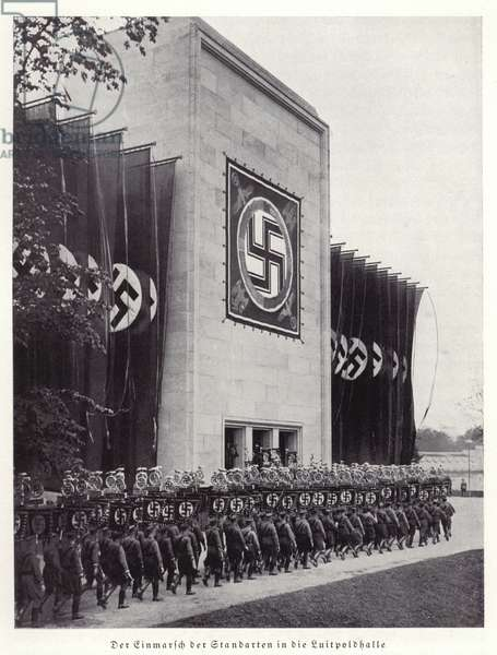 Nazi standards being marched into the Luitpold Hall, Nuremberg, 1936 (b/w photo)