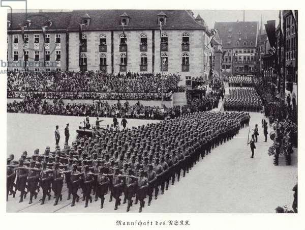 Members of the NSKK marching through Nuremberg, 1936 (b/w photo)
