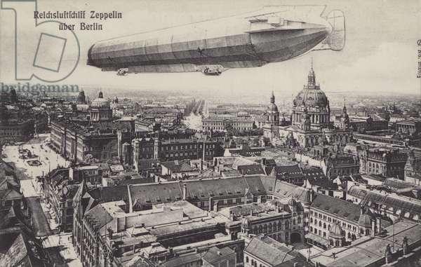 Zeppelin airship flying over Berlin (b/w photo)
