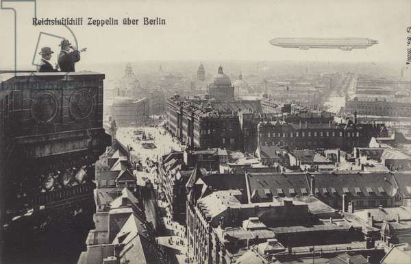 Zeppelin airship flying over Berlin (b/w photo)