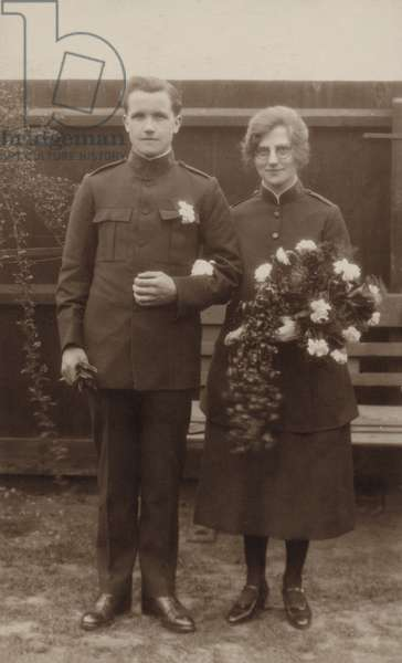 Newly married couple in Salvation Army uniforms (b/w photo)