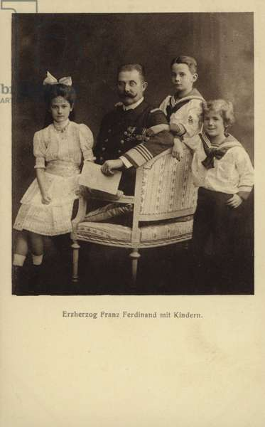 Archduke Franz Ferdinand of Austria with his children: Princess Sophie of Hohenberg; Maximilian Duke of Hohenberg; Prince Ernst of Hohenberg. (b/w photo)