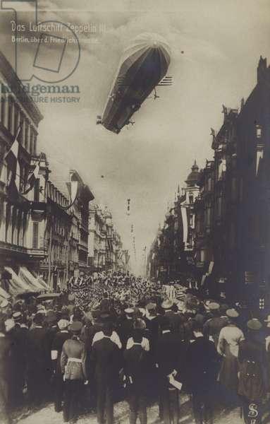Zeppelin LZ III flying above Friedrichstrasse, Berlin (b/w photo)