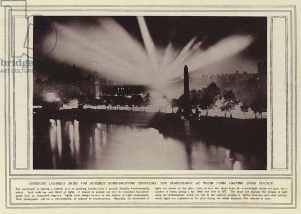 Sweeping London's skies for possible bomb-dropping Zeppelins, the searchlight at work from Charing Cross Station (b/w photo)