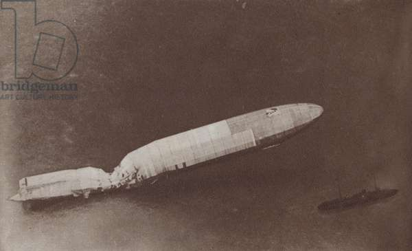 German Zeppelin shot down over the English Channel being towed back to Ostend, World War I (b/w photo)