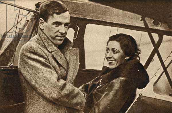British aviator Amy Johnson bidding farewell to her husband, Jim Mollison, before setting off on her record-breaking flight to South Africa, 1932 (b/w photo)