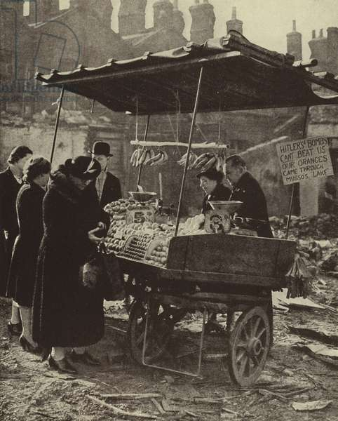 Greengrocer's stall defying the Blitz and keeping on trading, London, World War II, November, 1940 (b/w photo)