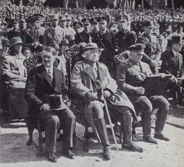 German President Paul von Hindenburg sitting between his Chancellor, Nazi Party leader Adolf Hitler, and Hermann Goering, premier of Prussia, at the commemoration of the First World War Battle of Tannenberg, 1933 (b/w photo)
