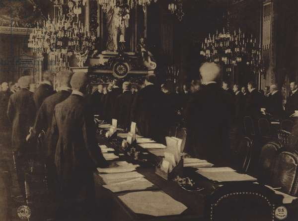 America in World War I: Delegates of 27 Allied nations standing while the President of France, Raymond Poincare, opens the Peace Conference with formal address, January 18, 1919 (b/w photo)