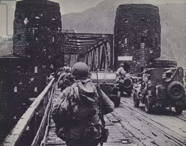 The US 1st Army become the first Allied troops across the Rhine after capturing the Bridge at Remagen, Germany, World War 2, March 1945 (b/w photo)