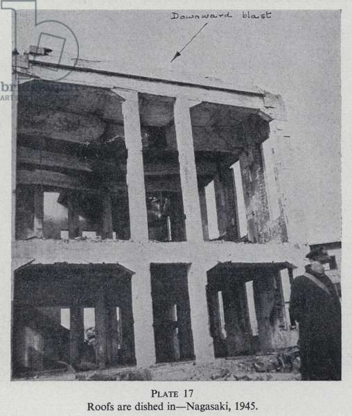 Building damaged by the explosion of the atom bomb dropped on Nagasaki, Japan, World War II, 1945 (b/w photo)