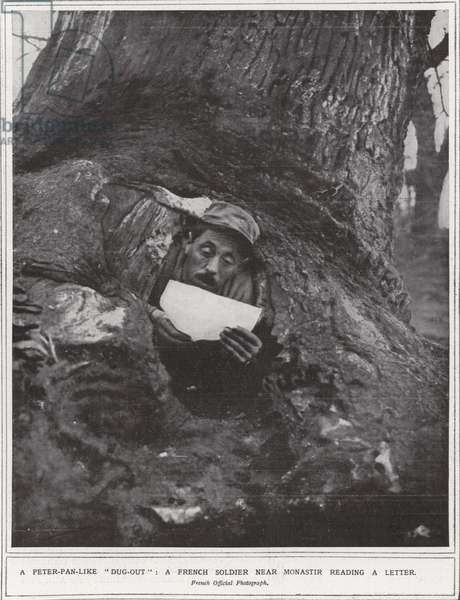 "A Peter-Pan-like ""dug-out"", a French soldier near Monastir reading a letter (b/w photo)"