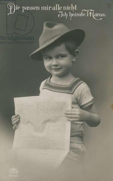 Postcard of a German boy, reading newspaper, 1913 (b/w photo)