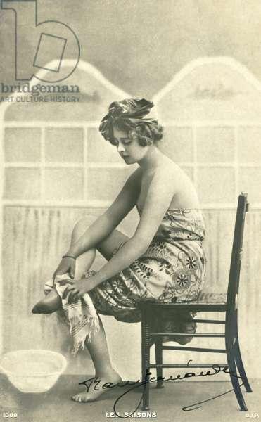 Woman in a bath towel (b/w photo)