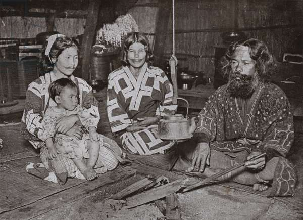 Ainu Man and Women at Home (b/w photo)