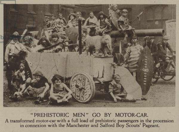 """Prehistoric Men"" go by motor-car (b/w photo)"