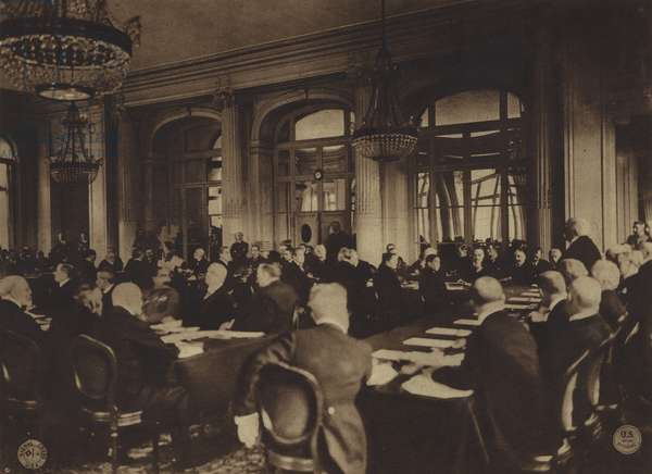America in World War I: Georges Clemenceau, premier of France, delivering to the German delegates the Allies' terms of peace in the Trianon Palace Hotel, Versailles, May 7, 1919 (b/w photo)