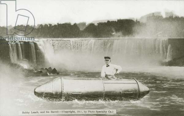 American stuntman Bobby Leach and the barrel in which he went over Niagara Falls, 1911 (b/w photo)